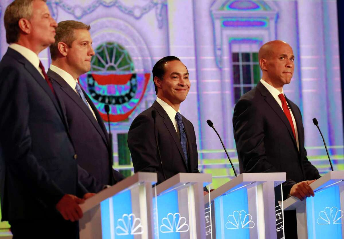 Democratic presidential candidates former Housing Sec. Julian Castro, second from right, smiles, during the Democratic primary debate hosted by NBC News at the Adrienne Arsht Center for the Performing Art, Wednesday, June 26, 2019, in Miami. (AP Photo/Wilfredo Lee)