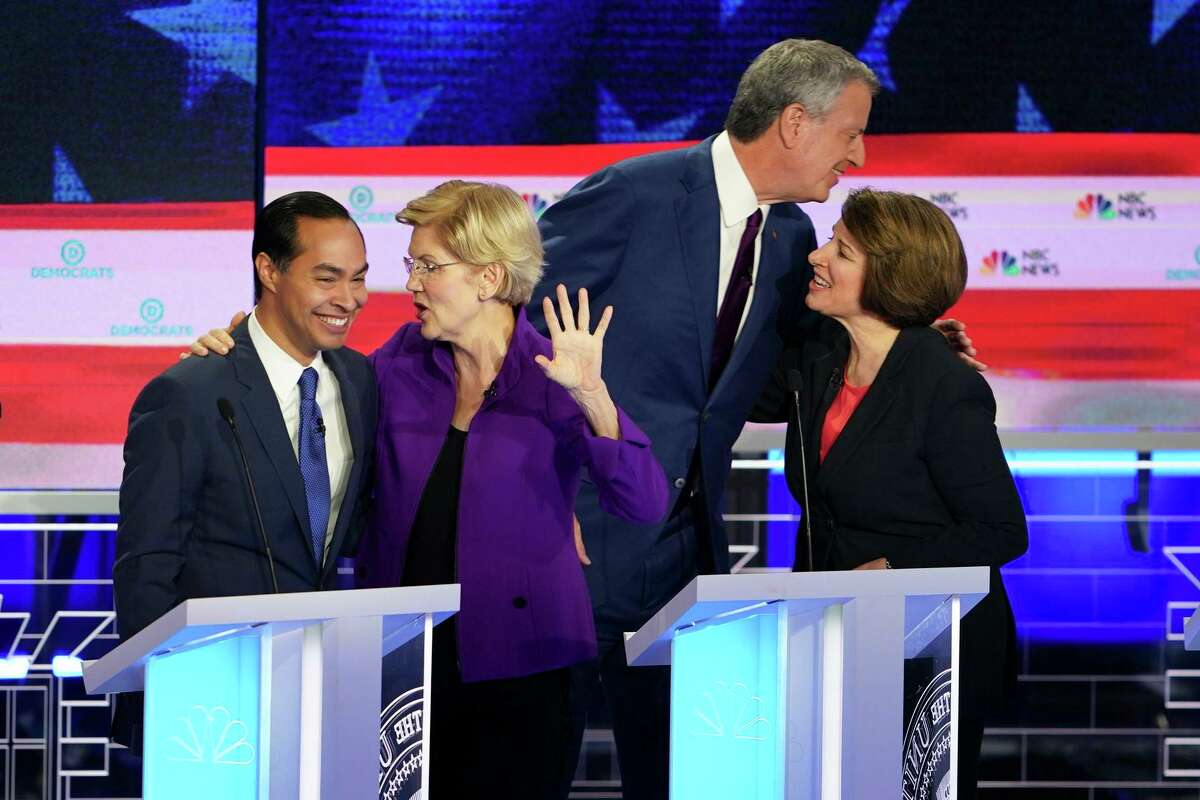 Sen. Elizabeth Warren (D-Mass.) and Julian Castro, left, speak after the first Democratic presidential debate in Miami, June 26, 2019. Warren, the only person on the stage Wednesday polling in double digits, was expected to be the star of the first Democratic debate - and for the first half-hour, she was. But by the end, Castro was among lower-polling candidates who had taken the spotlight. (Doug Mills/The New York Times)