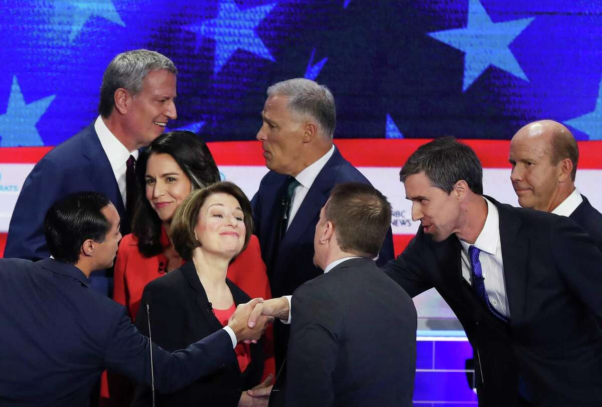 MIAMI, FLORIDA - JUNE 26: Chuck Todd of NBC News greets Sen. Amy Klobuchar (D-MN), former housing secretary Julian Castro, former Texas congressman Beto O'Rourke and other candidates after the first night of the Democratic presidential debate on June 26, 2019 in Miami, Florida. A field of 20 Democratic presidential candidates was split into two groups of 10 for the first debate of the 2020 election, taking place over two nights at Knight Concert Hall of the Adrienne Arsht Center for the Performing Arts of Miami-Dade County, hosted by NBC News, MSNBC, and Telemundo. (Photo by Joe Raedle/Getty Images) ***BESTPIX***