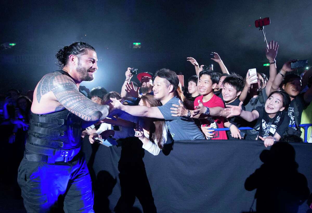 WWE Superstar Roman Reigns greets fans at a July 2017 show in Tokyo.