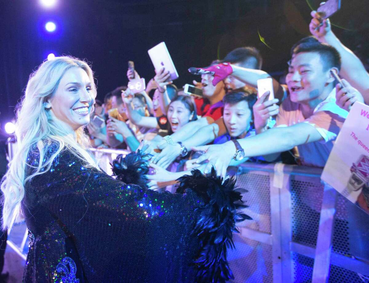 WWE Superstar Charlotte Flair greets fans at a September 2017 show in Shenzhen, China.