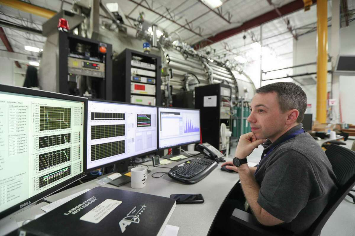 Matthew Giambusso, Ad Astra Rocket Company senior research scientist looks at monitors for the 150 m3 vacuum chamber on June 4, 2019, in Houston. Ad Astra Rocket Co., is working to develop a different kind of rocket engine that would be cheaper and faster than traditional chemical combustion.