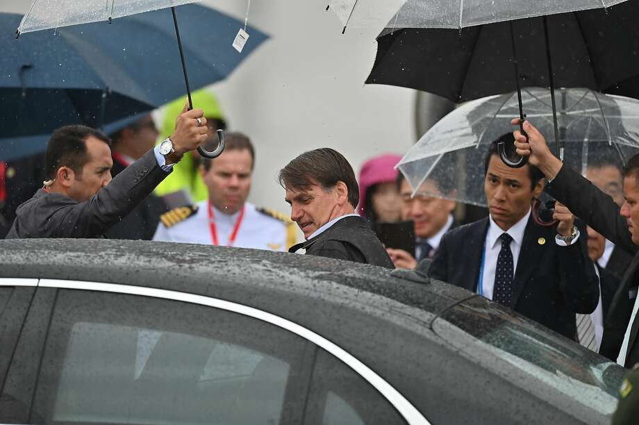President Jair Bolsonaro arrives in Izumisano city, Japan, to attend the Group of 20 summit. Photo: Charly Triballeau / AFP / Getty Images