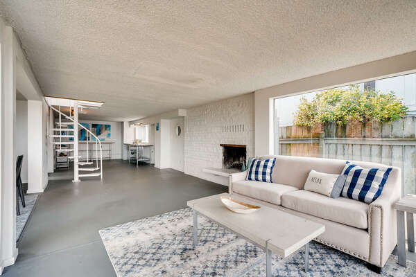 Paint and outfit as it, remodel, or start anew: beachfront property asks for imagination and $1.3M