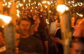 Neo Nazis, Alt-Right, and White Supremacists taking part in a march through the University of Virginia campus the night before the deadly 'Unite the Right' rally in Charlottesville, VA. The growth of online radicalism requires the private sector to come together for solutions.