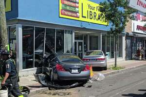 Two cars crashed into a building in Bridgeport, Conn., on Thursday, June 27, 2019.