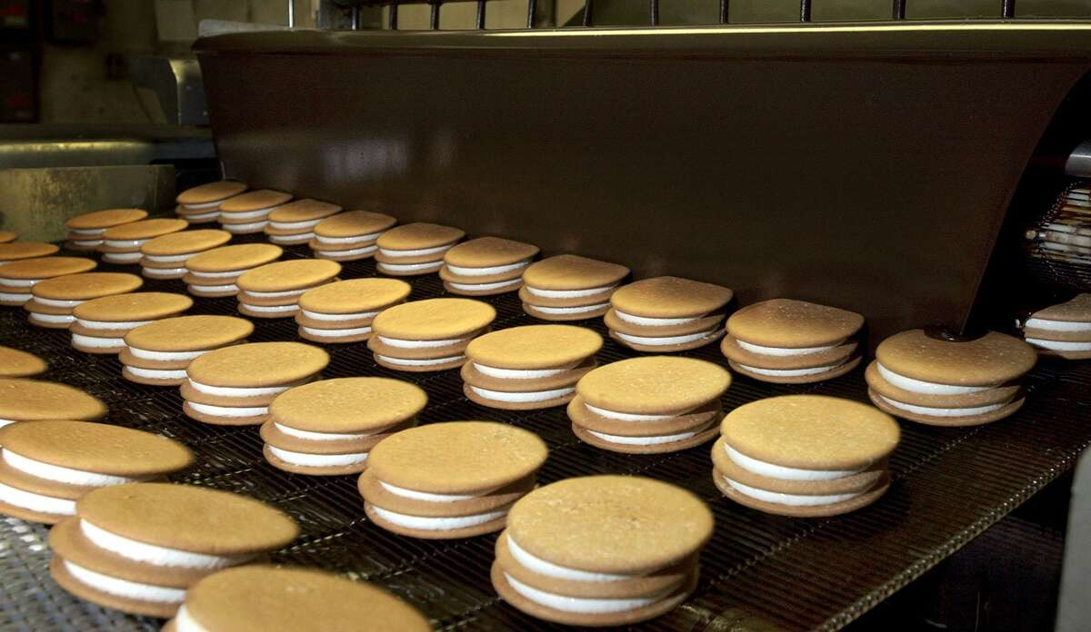 MoonPies ride on the chocolate coating assembly line at the Chattanooga Bakery in Chattanooga, Tenn. The sticky-sweet confection of marshmallow-stuffed graham cookies is over 100 years old.