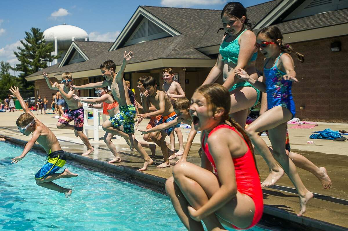 Kids swim in Plymouth Pool in a past summer in Midland. (Katy Kildee/kkildee@mdn.net)