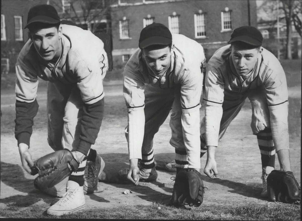 Click through the slideshow of people and places in the Capital Region in 1949. Baseball players pose at Milne High School, Albany, New York - Ed Lux, Ed Segel, and Art Walker. April 05, 1949 (Times Union Archive)