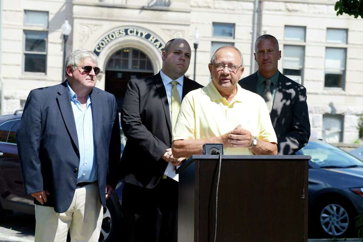 Gill Ether, chairman of Cohoes Democratic party and deputy majority leader of the Albany county legislator, center, introduces City Councilmember Steve Napier, back center, and Democratic mayoral candidate William Keeler, right, at a press conference on Thursday, June 27, 2019 in front of Cohoes City Hall in Cohoes, N.Y. (Catherine Rafferty/Times Union)