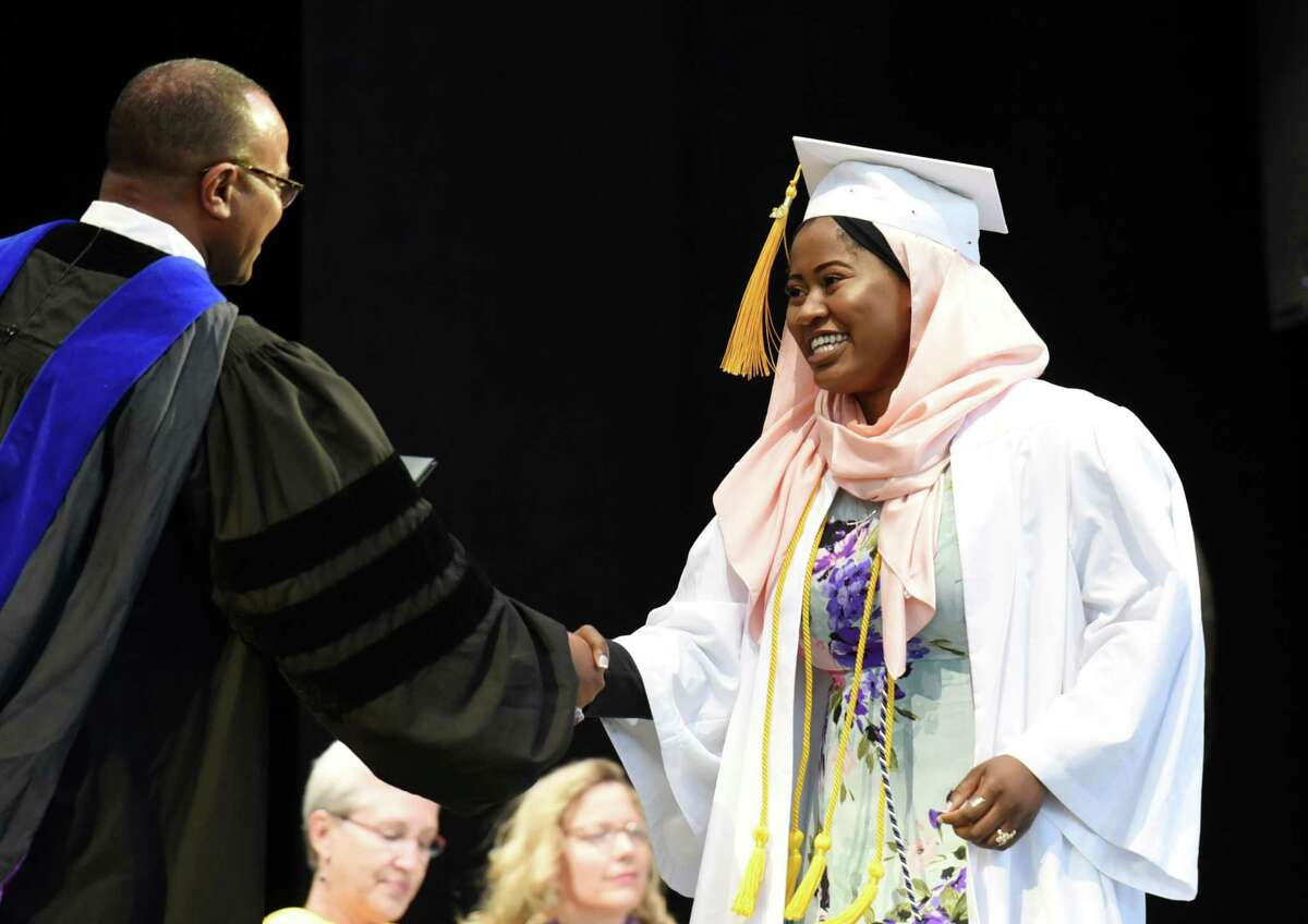 Rahimat Abdul-Rahman shakes hands with superintendent Dr. L. Oliver Robinson as she walks across stage to receive her degree during Shenendehowa's Graduation on Thursday, June 27, 2019 at the Saratoga Performing Arts Center in Saratoga Springs, NY. (Phoebe Sheehan/Times Union)