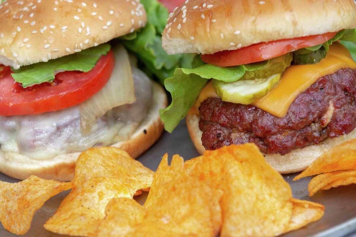 Smoked Onion Cheeseburger, left, and Blue Cheese-Stuffed Smoked Burger
