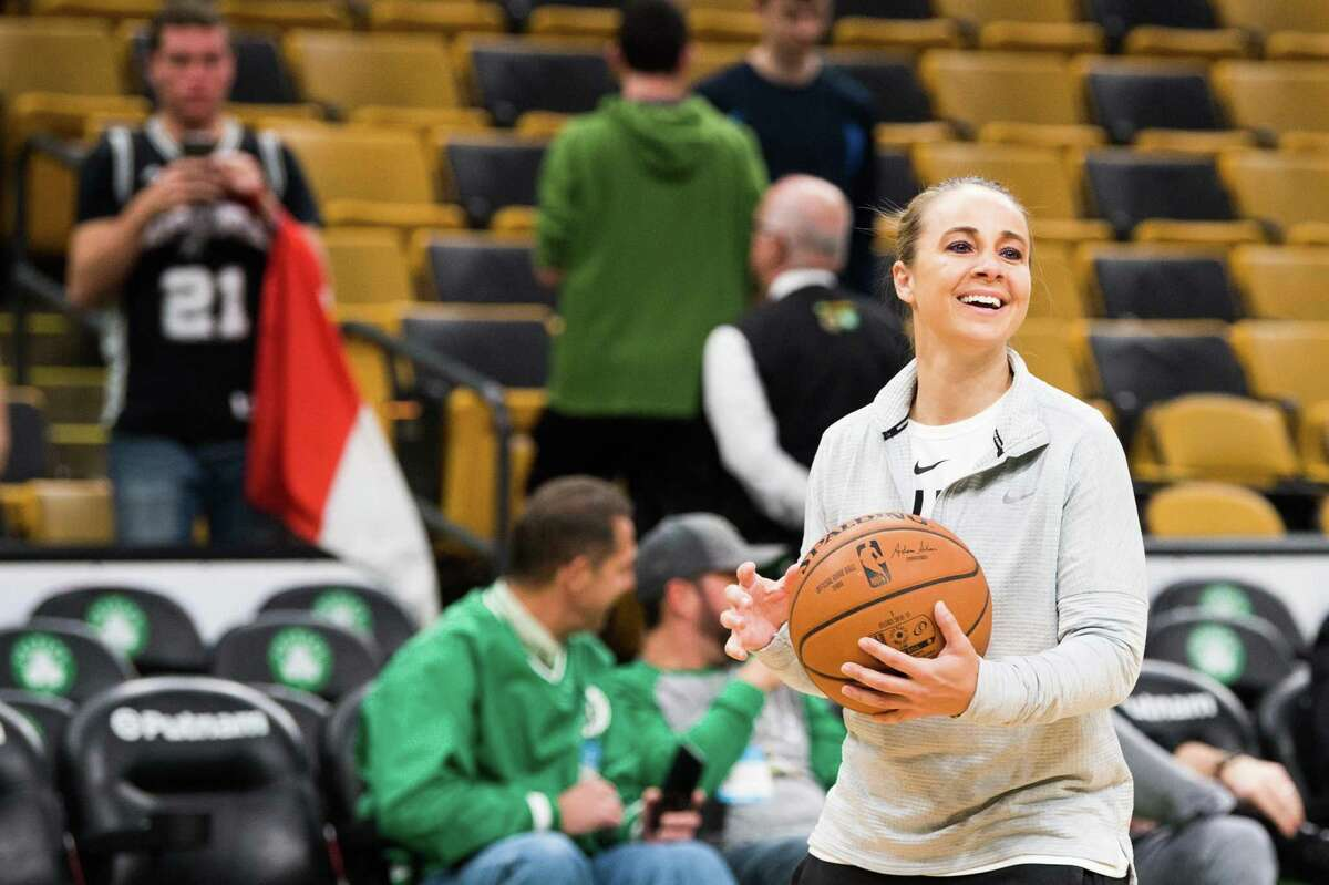 San Antonio Spurs assistant coach Becky Hammon smiles during a pre-game shoot around before a game against the Boston Celtics at TD Garden on March 24, 2019 in Boston, Massachusetts.
