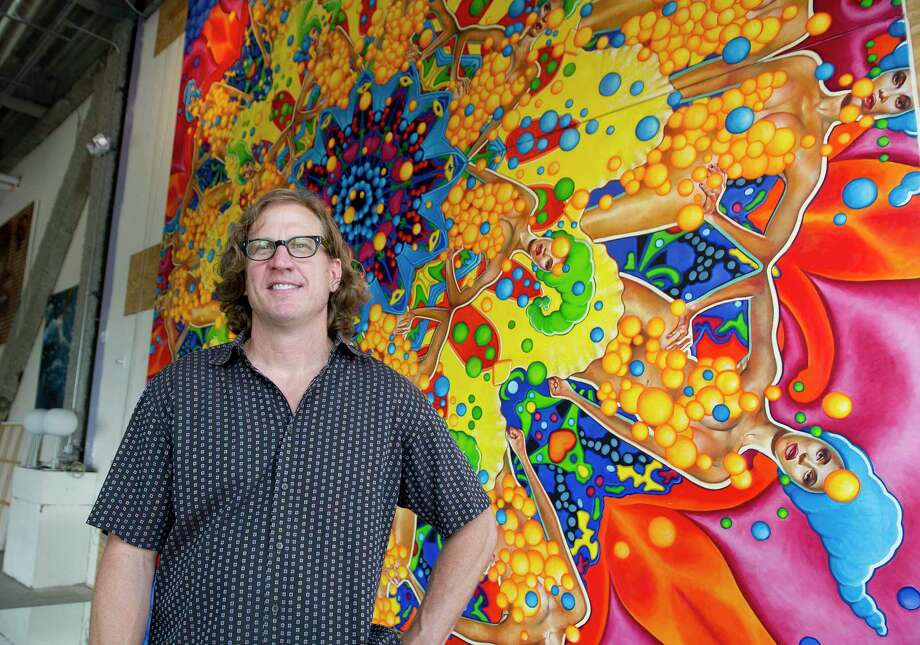 """William Nelson poses for a photo with his painting, """"Aphrodite Redux,"""" in his gallery in Stamford, Conn., on Thursday, June 26, 2014. Nelson is selling prints of his painting to benefit the Yerwood Center. Photo: Lindsay Perry / Stamford Advocate / Stamford Advocate"""
