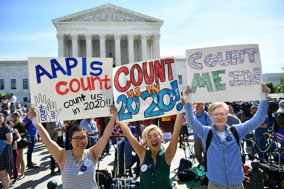 (FILES) In this file photo taken on April 23, 2019, demonstrators rally at the US Supreme Court in Washington, DC, to protest a proposal to add a citizenship question in the 2020 Census. - The court in a 5-4 decision on June 27, 2019, barred the addition of a citizenship question to the 2020 Census. (Photo by MANDEL NGAN / AFP)MANDEL NGAN/AFP/Getty Images