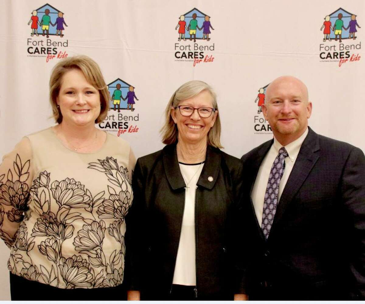 Fort Bend Cares Board Chair Grayle James, center, recognized major supporter and Grants Reception Sponsor Houston Methodist Sugar Land Hospital, represented by Christina Stanton and Chief Financial Officer Lowell Stanton.