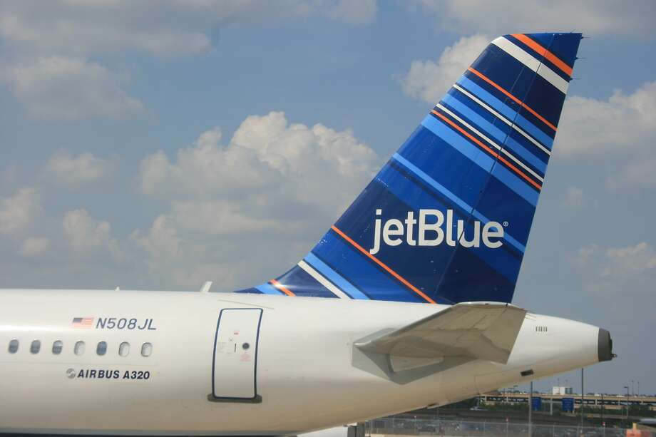 FILE - JetBlue flies to Hobby Airport in Houston, Tex. from New York. A former gate agent faces prison time after upgrading 505 ticket exchanges worth $785,000. Photo: Bill Montgomery, Houston Chronicle