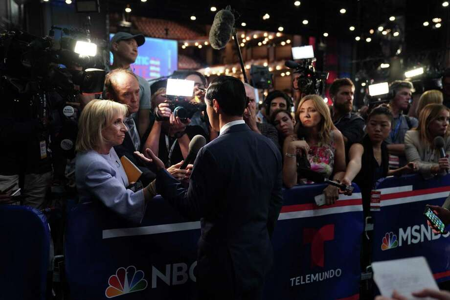 "Former Housing Secretary Julian Castro speaks to reporters after the close of the first Democratic presidential debate in Miami on Wednesday night, June 26, 2019. Political analysts on Telemundo, the Spanish-language network, declared Castro a clear winner of the evening, the ""gran protagonista"" seizing on the chance to set himself apart from Beto O'Rourke. (Doug Mills/The New York Times) Photo: DOUG MILLS, STF / NYT / NYTNS"