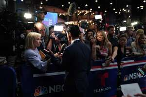 """Former Housing Secretary Julian Castro speaks to reporters after the close of the first Democratic presidential debate in Miami on Wednesday night, June 26, 2019. Political analysts on Telemundo, the Spanish-language network, declared Castro a clear winner of the evening, the """"gran protagonista"""" seizing on the chance to set himself apart from Beto O'Rourke. (Doug Mills/The New York Times)"""