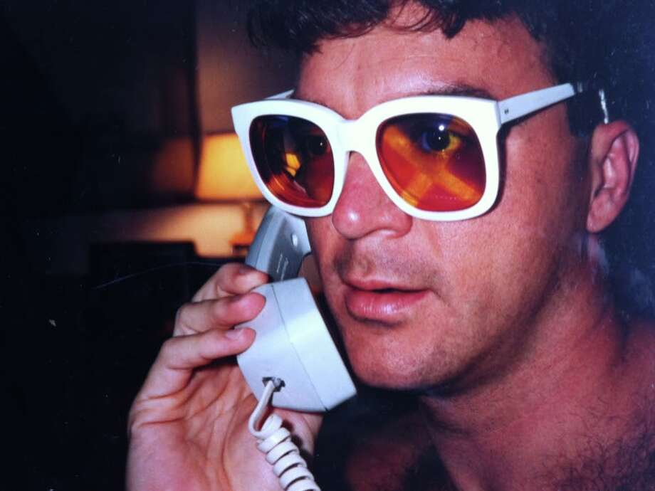 Chris McGinnis sporting a relatively tame pair of Elton John's wild glasses in 1992. Photo: Chris McGinnis