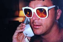 Chris McGinnis sporting a relatively tame pair of Elton John's wild glasses in 1992.
