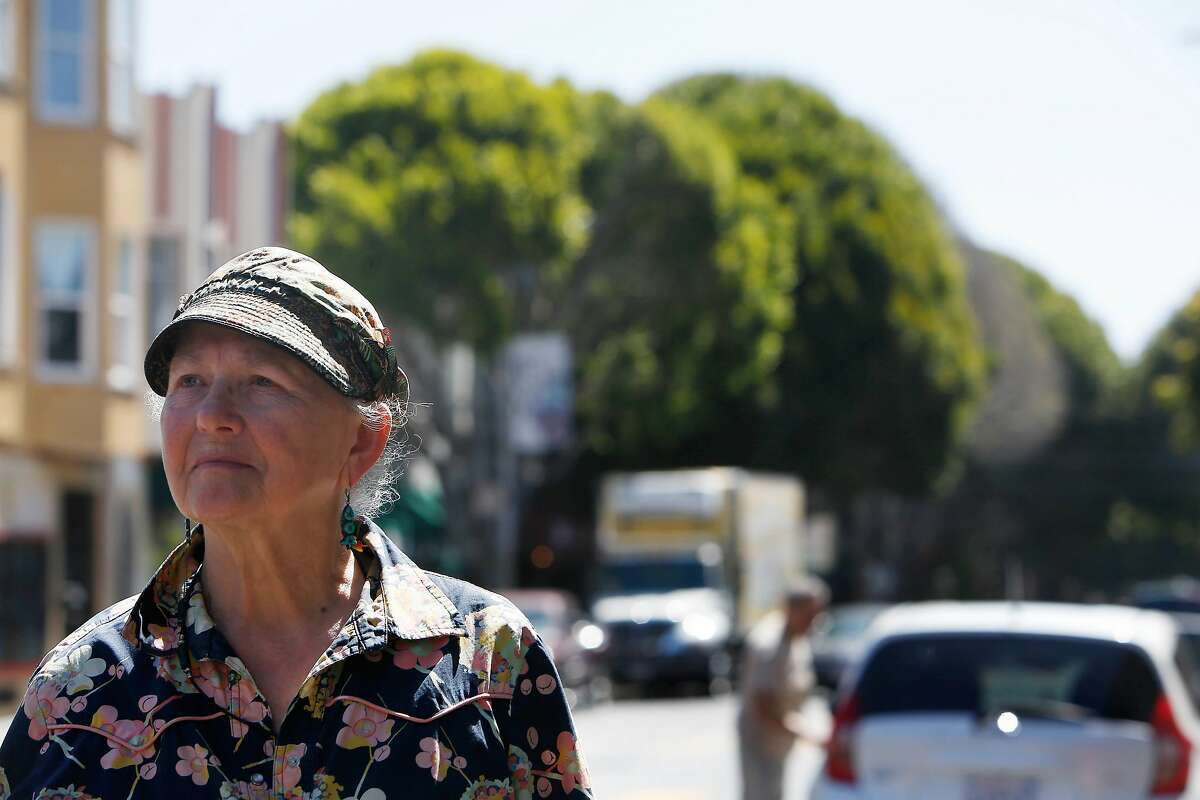 Susan Cervantes, founding executive director, stands for a portrait on 24th Street on Tuesday, June 25, 2019 in San Francisco, Calif. Behind Cervantes are trees on 24th Street.