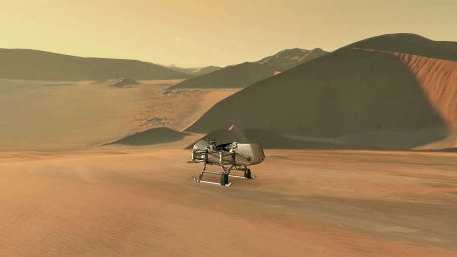 This illustration shows NASA's Dragonfly rotorcraft-lander approaching a site on Saturn's exotic moon, Titan. Taking advantage of Titan's dense atmosphere and low gravity, Dragonfly will explore dozens of locations across the icy world, sampling and measuring the compositions of Titan's organic surface materials to characterize the habitability of Titan's environment and investigate the progression of prebiotic chemistry. Photo: Credit: NASA/JHU-APL