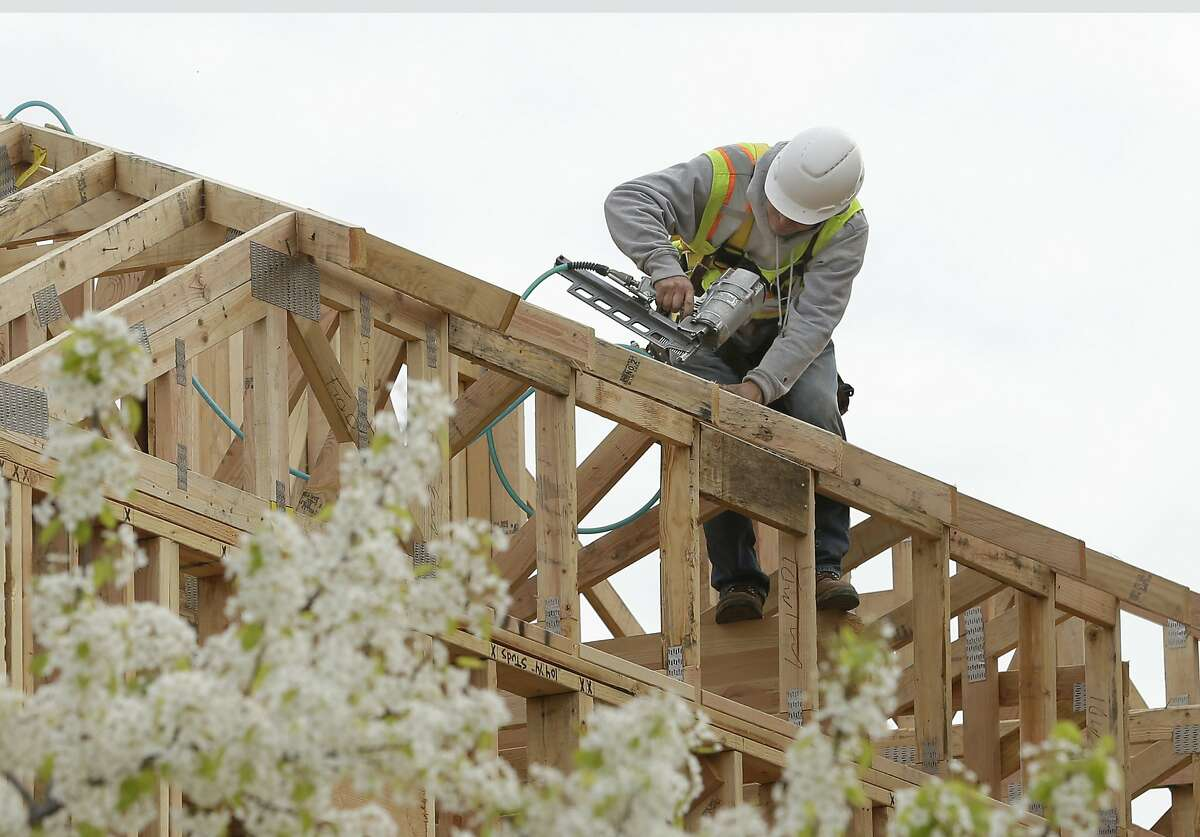 In this photo taken Feb. 8, 2019, work is done on an apartment building under construction in Sacramento, Calif. Proposals to cap rent increase, set new rules for evictions and cut red tape to build more housing have all faced tough political fights among California lawmakers. (AP Photo/Rich Pedroncelli)