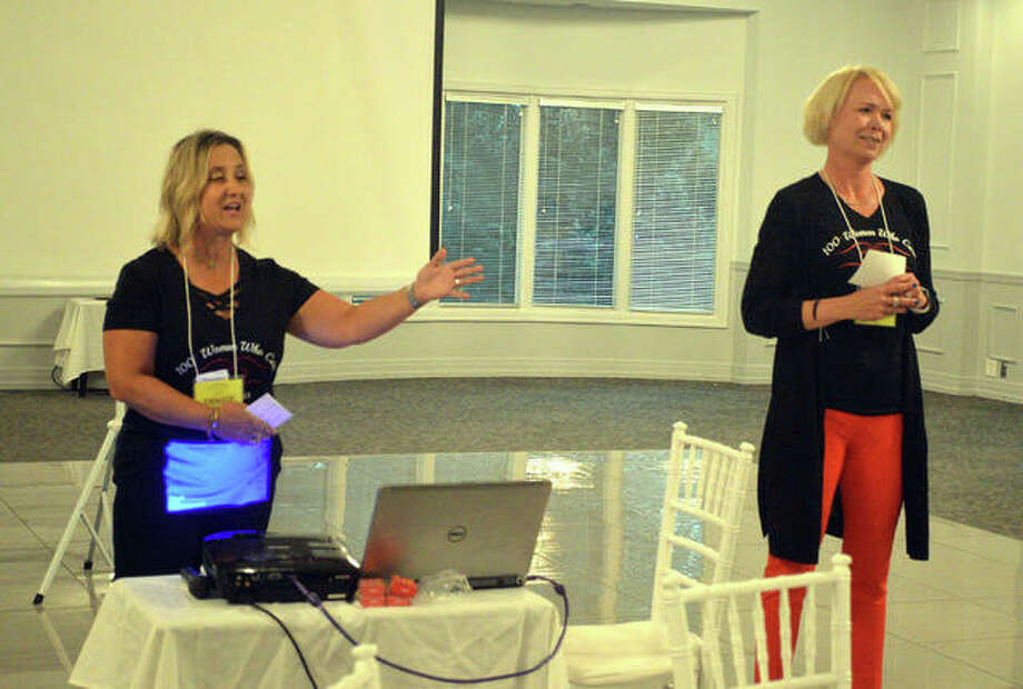 100+ Women Who Care from the 618 co-directors Denise Arendell, left, and Sarah Rankin answer questions from prospective members during an informational open house Wednesday at Sunset Hills Country Club in Edwardsville. Photo: Scott Marion | The Intelligencer