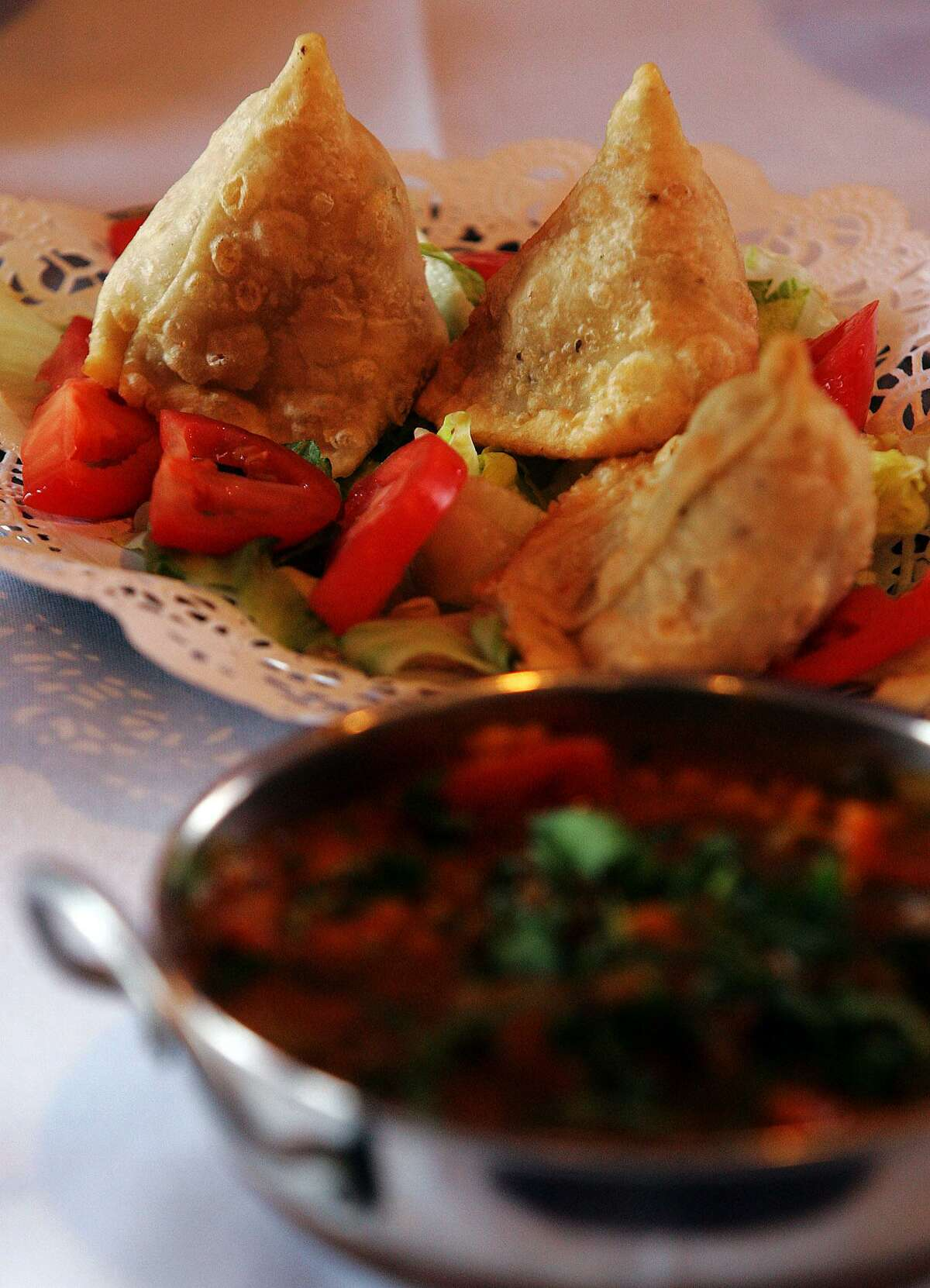 India Oven serves up vegetable samosas (top) along with Daal meat.
