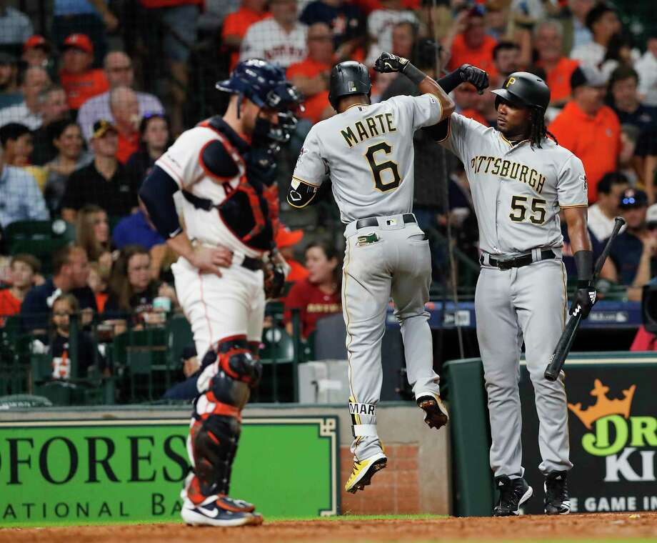 Max Stassi of the Houston Astros reacts as Josh Bell (55) of the Pittsburgh Pirates congratulates Starling Marte (6) after a solo home run in the fifth inning at Minute Maid Park on June 27, 2019 in Houston. Photo: Tim Warner, Stringer / Getty Images / 2019 Getty Images