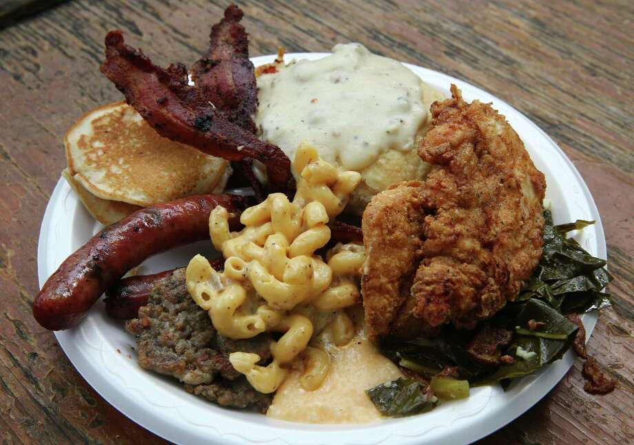Brunch at The Pigpen includes sausage, brisket, biscuits, fried chicken, greens, macaroni and cheese and more. Photo: Jerry Lara /Staff / © 2019 San Antonio Express-News