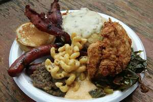 Brunch at The Pigpen includes sausage, brisket, biscuits, fried chicken, greens, macaroni and cheese and more.