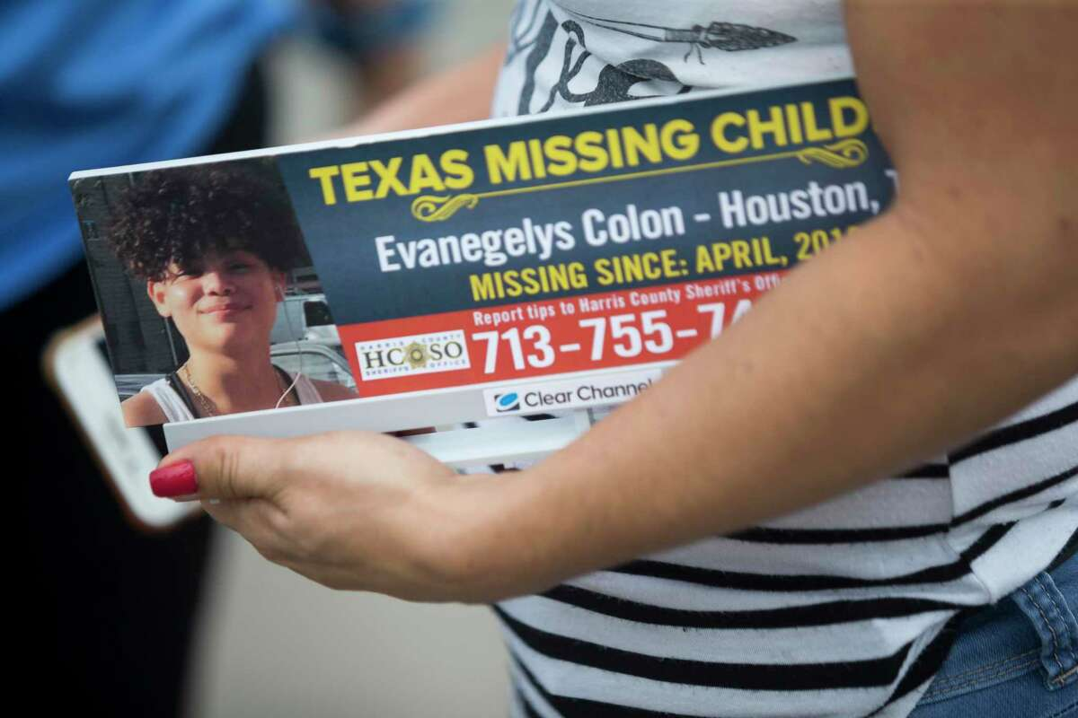 Angelica Colon Padua holds a replica of the billboard broadcasting her missing daughter Evanegelys Colon, a 16-year-old who went missing in April, following a press event by the Texas Center for the Missing and Clear Channel Outdoors Americas in Humble, Thursday, June 27, 2019.