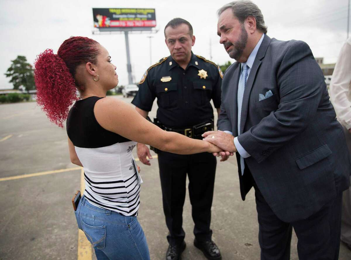 Chief Deputy Edison Toquica, center, and Lee Vela, Vice President of Public Affairs at Clear Channel Outdoor, offer Angelica Colon Padua their support following a press event launching a month-long effort between Texas Center for the Missing and Clear Channel Americas to help generate leads to find Padua's missing daughter Evanegelys Colon in Humble, Thursday, June 27, 2019.