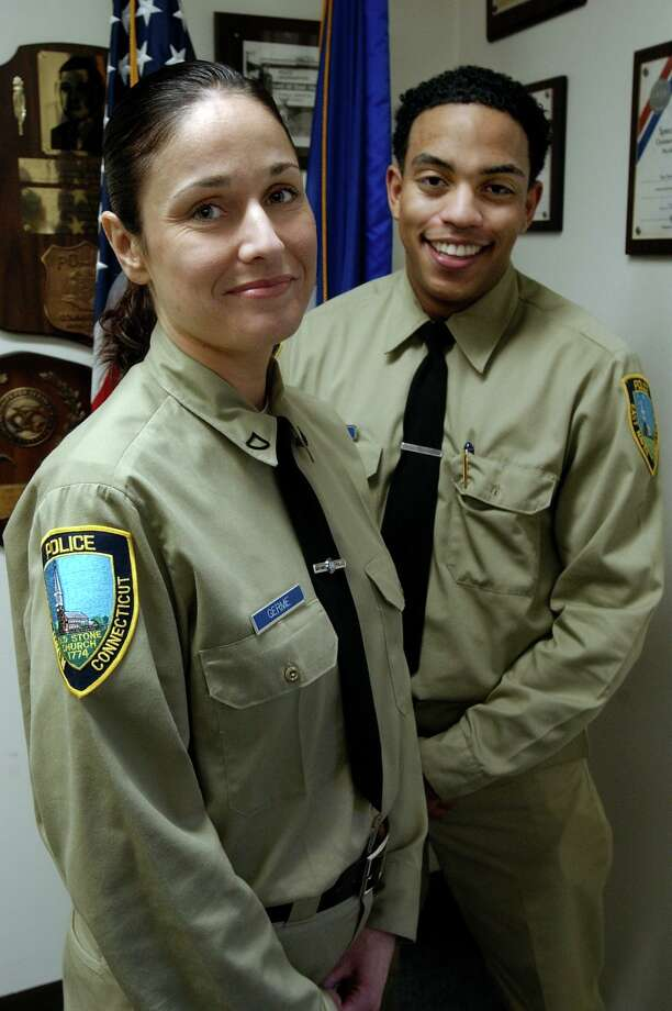 Former East Haven Police Det. Danielle Germe, left, with fellow recruit (now Lt.) Joseph Murgo when she was first hired as a recruit in 2004. The town has agreed to pay Germe — the first female detective in the Police Department's history -- $90,000 as part of a settlement of a federal lawsuit she filed in 2015. The suit alleged that she was subject to harassment based on her gender before taking early retirement in 2014. Photo: Mara Lavitt / New Haven Register File Photo