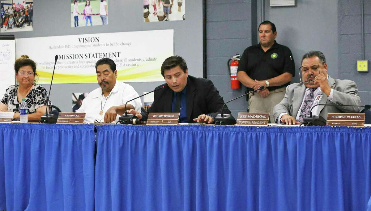 President Ricardo Moreno, center, takes part in a recent Harlandale ISD board meeting. Lawyers have billed the district $100,334 as of April 1 to respond to a state investigation begun in 2017.