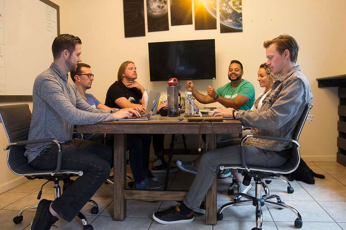 At the Epic Entrepreneur House, the foyer looks more like a conference room, where the roommates hold meetings to discuss performance, goals and strategy, on June 17, 2019, in San Diego. (John Gibbins/San Diego Union-Tribune/TNS)