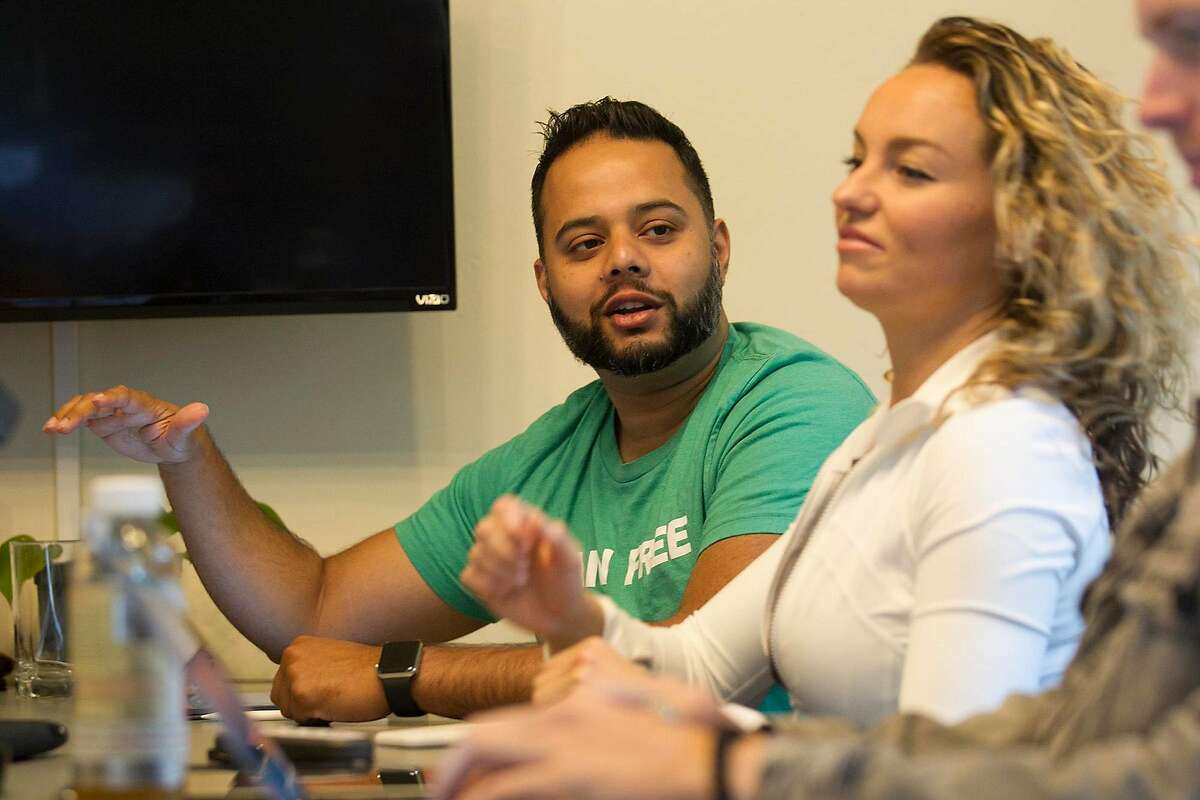 Shiv Shukla and Lian Price during their weekly meeting where the roommates hold meetings to discuss performance, goals and strategy, on June 17, 2019, in San Diego. (John Gibbins/San Diego Union-Tribune/TNS)