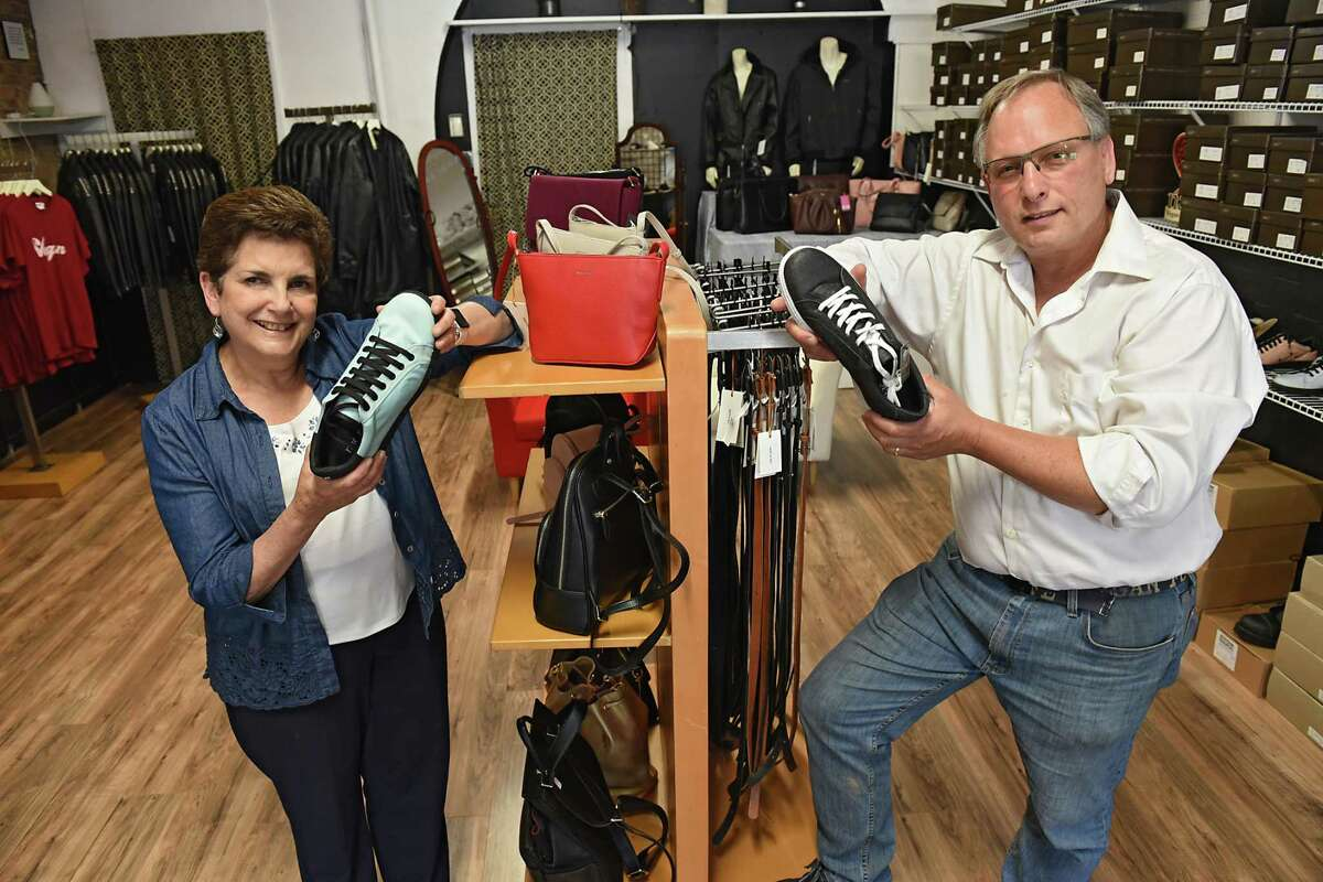 Store owners Susan and Jed Civic hold shoes made from car airbags, left, and Pinatex, which is made from pineapple leaves, right, in their store The Vegan Outfitter on Thursday, June 27, 2019 in Troy, N.Y. This is the only vegan shop in the Capital Region and carries high quality, cruelty-free shoes, jackets, belts, handbags, wallets and more. (Lori Van Buren/Times Union)