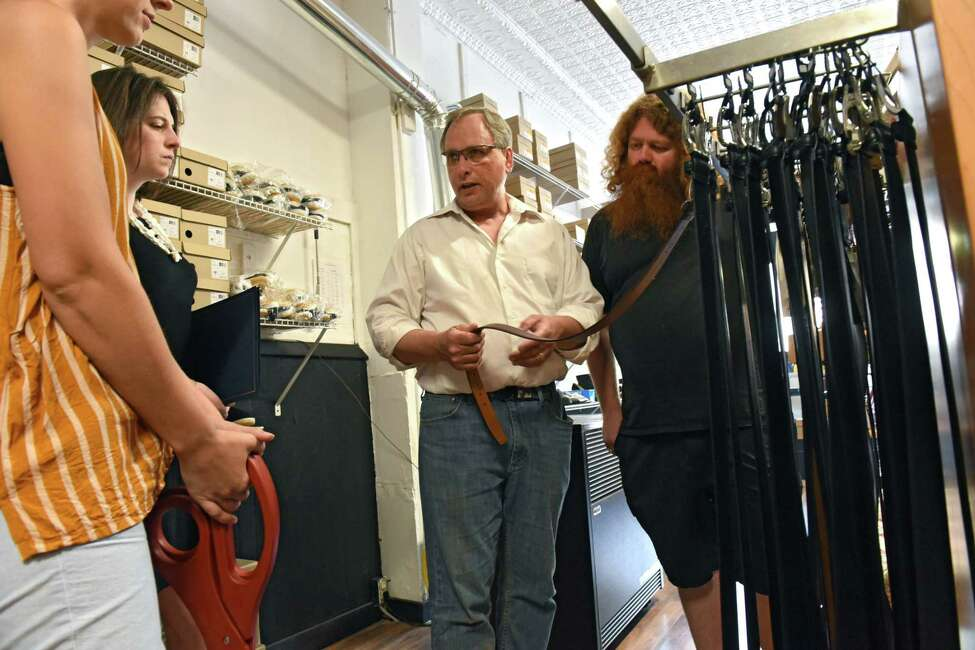 Owner Jed Civic shows city officials the vegan belts in The Vegan Outfitter on Thursday, June 27, 2019 in Troy, N.Y. This is the only vegan shop in the Capital Region and carries high quality, cruelty-free shoes, jackets, belts, handbags, wallets and more. (Lori Van Buren/Times Union)