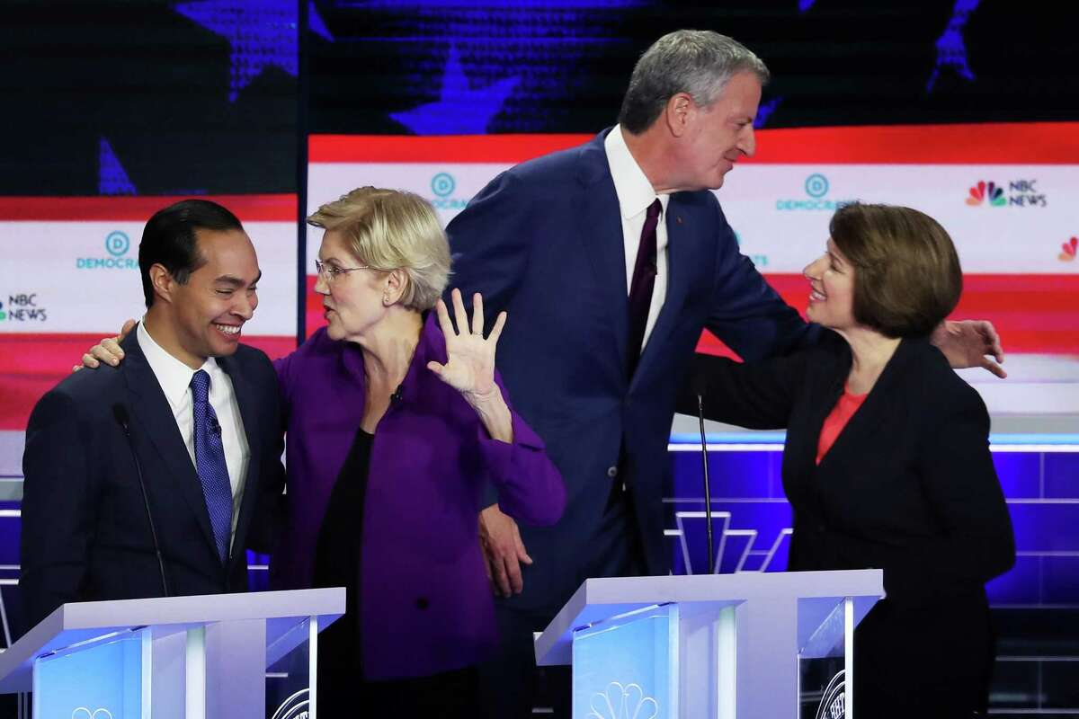 MIAMI, FLORIDA - JUNE 26: (L-R) Former housing secretary Julian Castro, Sen. Elizabeth Warren (D-MA) New York City Mayor Bill De Blasio and Sen. Amy Klobuchar (D-MN) embrace after the first night of the Democratic presidential debate on June 26, 2019 in Miami, Florida. A field of 20 Democratic presidential candidates was split into two groups of 10 for the first debate of the 2020 election, taking place over two nights at Knight Concert Hall of the Adrienne Arsht Center for the Performing Arts of Miami-Dade County, hosted by NBC News, MSNBC, and Telemundo. (Photo by Joe Raedle/Getty Images)