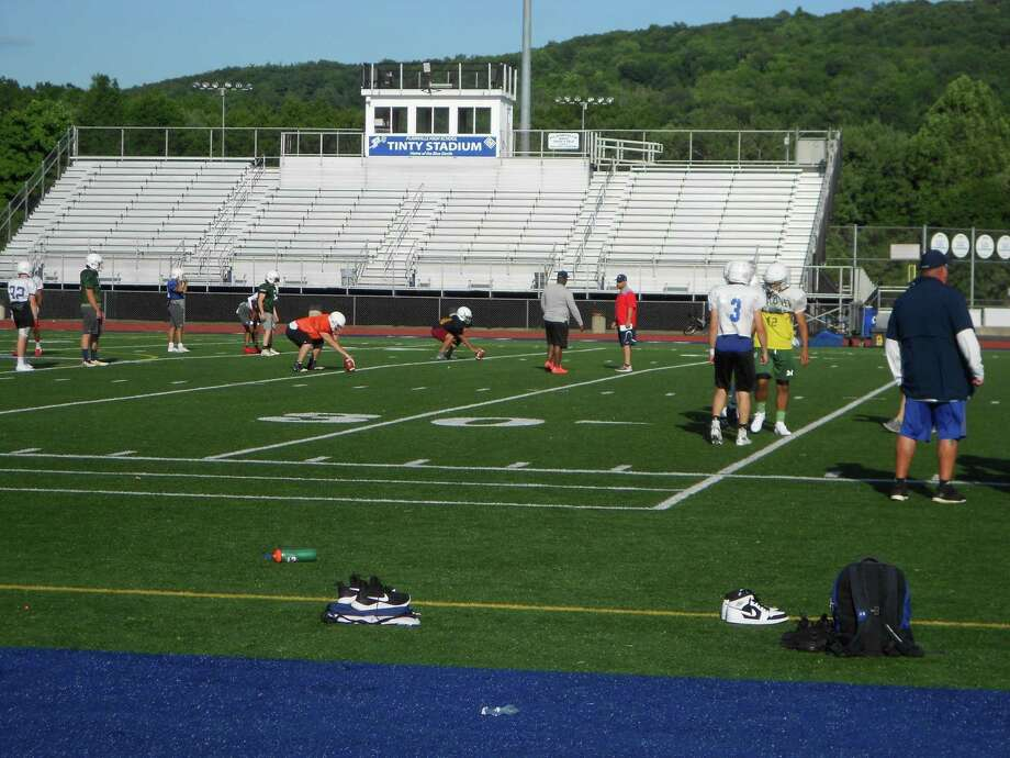 Players and coaches from Team Constitution practice on Thursday, June 27, 2019, at Plainville (Conn.) High for the Super 100 Classic, scheduled for Saturday, June 29, at Veterans Stadium in New Britain, Conn. Photo: Michael Fornabaio / Hearst Connecticut Media