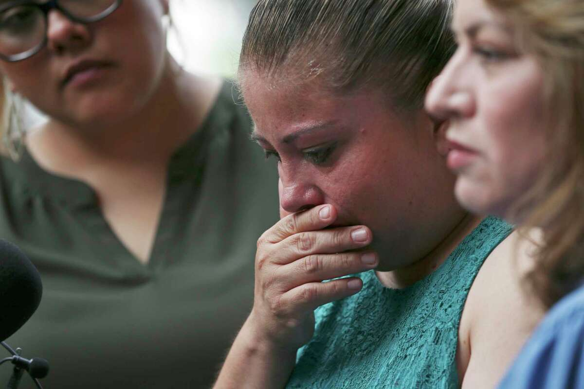 Veronica De Leon, center, is joined by her sister-in-law, Andrea Garcia, right, at a news conference about her missing daughter and a digital billboard displaying her daughter's likeness.