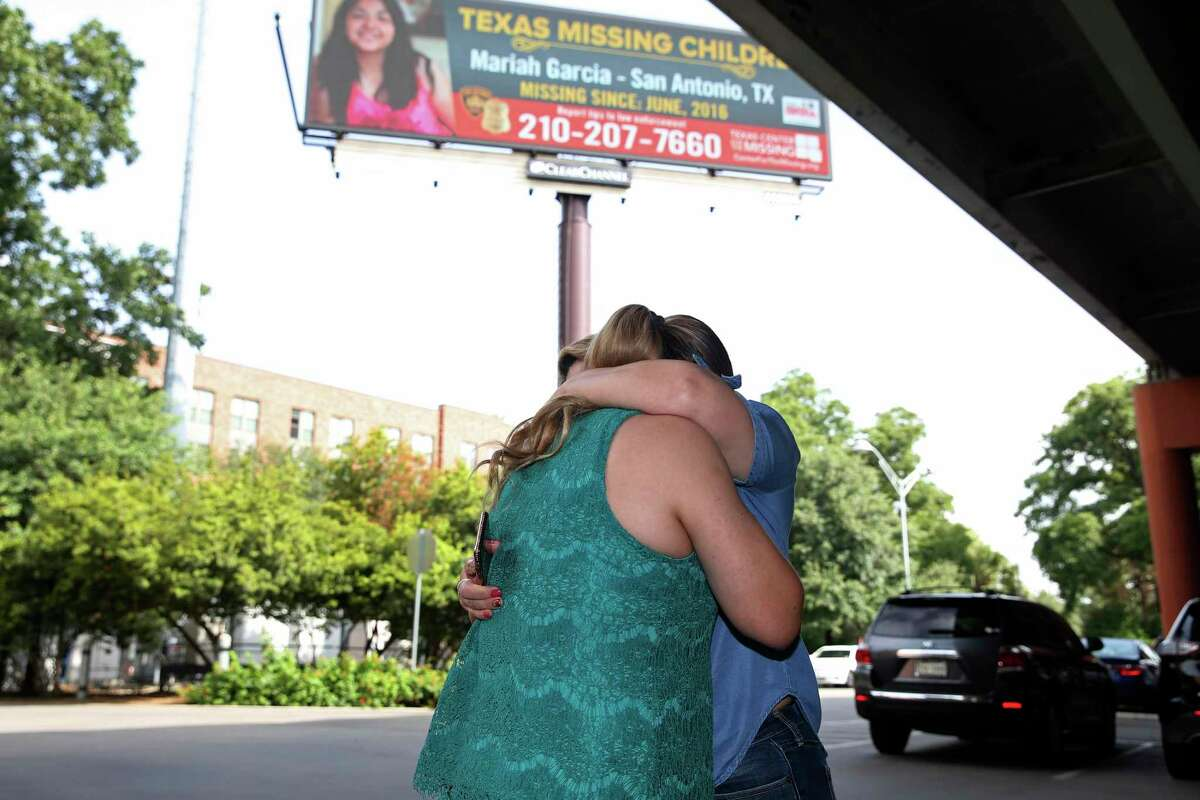 Veronica De Leon, in green, is hugged by her sister-in-law, Andrea Garcia, after seeing her missing daughter?•s digital billboard before a press conference at the Pearl, Thursday, June 27, 2019. De Leon?•s daughter, Mariah Garcia, was 14-years-old when she went missing on June 16, 2016. San Antonio Police Department and Clear Channel Outdoors Americas-San Antonio announce a months long effort during which digital billboards in San Antonio and the surrounding region will display her missing person poster a total of 1,200 times a day in the hopes of bringing attention and leads to her case.