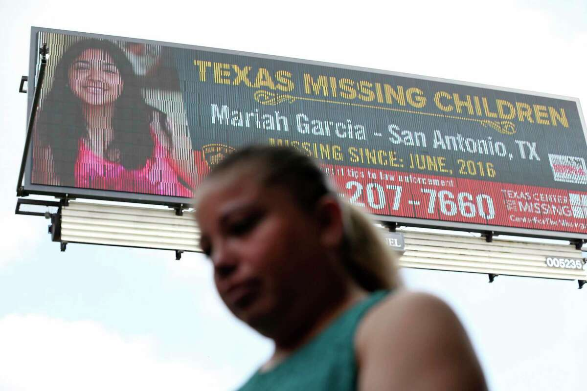Veronica De Leon joins a press conference by a digital billboard with her daughter's missing person poster at the Pearl on Thursday.