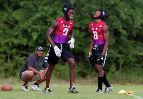 New Caney defensive back Ladarian Henson (8) reacts after Jaylen Neal (9) is called for defensive pass interference during a game at Texas State 7-on-7 tournament at Veterans Park and Athletic Complex on Saturday, June 30, 2018, in College Station.