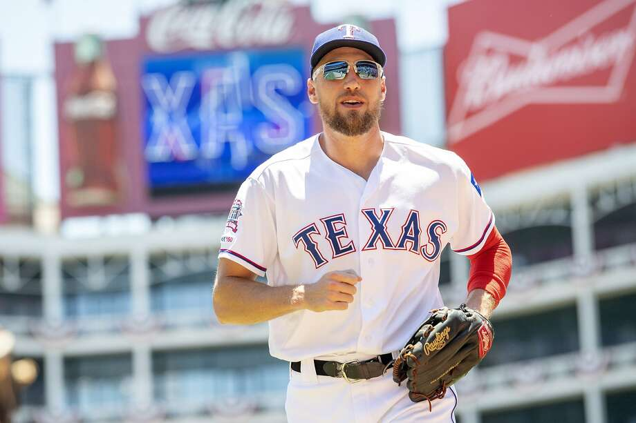 Texas Rangers' Hunter Pence runs to the dugout before the first baseball game of a doubleheader against the Oakland Athletics Saturday, June 8, 2019, in Arlington, Texas. Texas won 10-5. (AP Photo/Jeffrey McWhorter) Photo: Jeffrey McWhorter / Associated Press