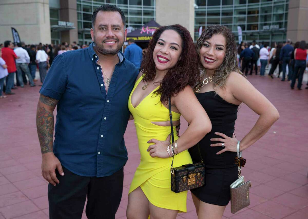Luis Miguel fans pose for a photograph at the Toyota Center on Thursday, June 27, 2019, in Houston.
