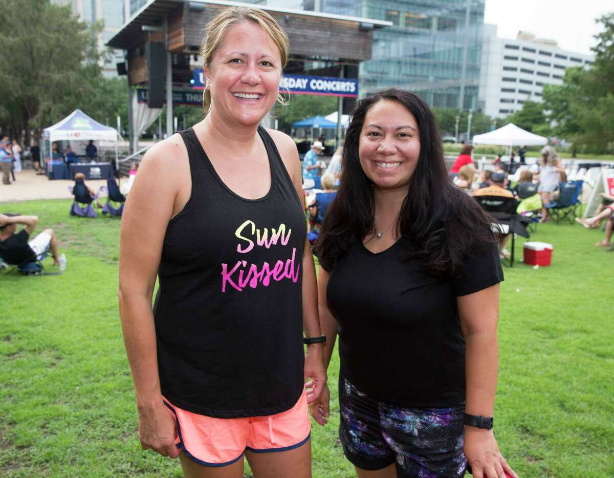 People pose for a photograph before Thursday Night Concerts with Bruce Robison and Kelly Willis at Discovery Green on Thursday, June 27, 2019, in Houston.